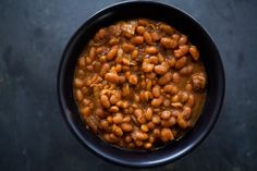 "Slowly cooked Boston baked beans, white beans cooked with salt pork and onions, in a molasses and mustard sauce. - Team EV says, ""It cold here today, so yummy baked beans would be great with fresh bread and butter! Slow Cooker Baked Beans, Crock Pot Slow Cooker, Crock Pot Cooking, Slow Cooker Recipes, Crockpot Recipes, Cooking Recipes, Simply Recipes, Great Recipes, Favorite Recipes"