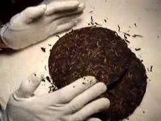 """""""Cloud"""" shows us how to break up a puer cake."""