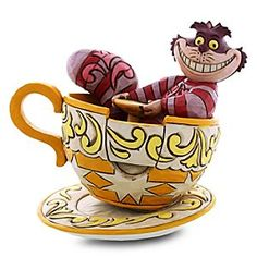 Disney Cheshire Cat in Tea Cup Figure by Jim Shore | Disney StoreCheshire Cat in Tea Cup Figure by Jim Shore - Join the maddest tea party ever with our grinning trickster, the Cheshire Cat, in a whirl on one of Wonderland's tipsiest tea cups! This feline figurine by Jim Shore combines folk art with pure fantasy! #disneyside