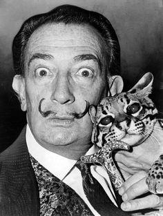 Salvador Dali and his pet ocelot, Babou