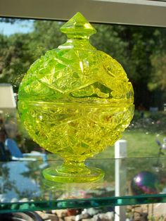 Love the way uranium glass looks in daylight. Garden Windows, Green Home Decor, Vaseline Glass, Antique Glassware, Fenton Glass, Candy Dishes, Candy Bowl, Glass Candy, Glass Birds