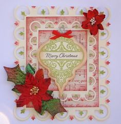 Angela Barkhouse has an elegant Christmas Card with beautiful layers Fleur De Lis Rectangles to frame and showcase JustRite's Deck the Halls, and Merry & Bright.  Angela die cut her stamped image with 2010 Heirloom Ornament,.  She used Petaloo Velvet Mini Poinsettia's, Assorted Red & Green Velvet Blossoms, Glass Ornament Pins in Red and Dark Green to accent her card.