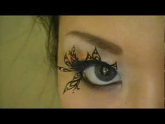 Paper-cut patterned faux eyelashes..not sure if I love 'em, or if I'm a little creeped out.  Definitely dramatic.