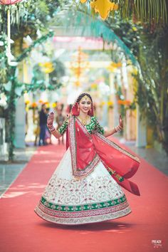 Wearing white, red and green lehenga with intricate gold embroidery | weddingz.in | India's Largest Wedding Company | Wedding Venues, Vendors and Inspiration | Indian Wedding Bridal Jewellery Ideas |