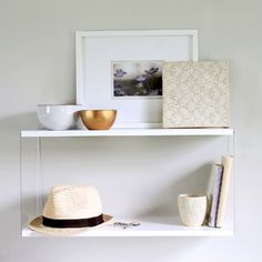 The West Elm Acrylic Sided Shelf is sleek and modern, but costs $189. Make your own version for just $20 instead!