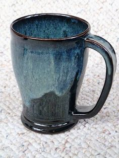 Stoneware mug by Shelley Duncan, glazed in Cone 6 Licorice with rim dipped in Mottled Glossy Dark Green