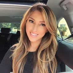 Long brown hair with blond highlights and side swept bangs