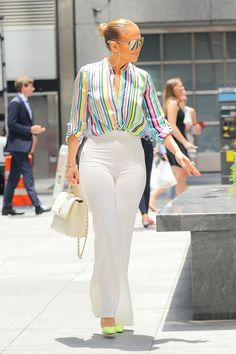Jennifer Lopez Rainbow Stripe Top and White Flare Pants Funky Outfits, White Outfits, Fashion Outfits, Work Outfits, Fashion Ideas, Women's Fashion, White Flare Pants, White Slacks, Jennifer Lopez