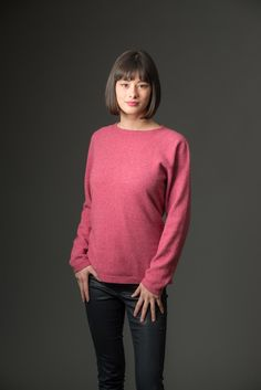 This new pink knit sweater design is a simple slightly widened round boat neck women's possum merino sweater with a shaped waist. It is easy wearing for the weekend or smart casual for during the day at work. Knitwear made in New Zealand.