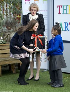 Delighted: The royal mother-to-be looked absolutely thrilled as the children presented her with the handmade gift