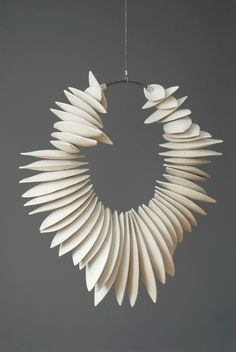 Marie-André Côté (ceramic) Could be beautiful in paper too? Or mod rock ?