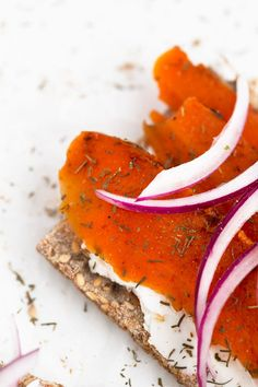 Vegan smoked salmon, made with natural ingredients. It's low in fat and the texture is on point. We served it on crackers with vegan cream cheese.