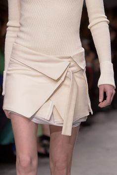 Inspiration. Make a liitle mini-skirt/apron (with pockets), that can be worn over a skirt, dress, or pants.