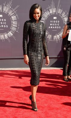 Chanel Iman at the 2014 MTV VMAs The model wowed in a skintight woven leather Balmain dress, which was finished off with a serious choker and Casadei cage sandals.