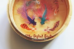 Two Siamese fish fight each other with some by TheGiftedStudio