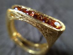 Gold plated silver folded ring with yellow by MetalStudioThailand, $75.00 this would be so rad with different stones