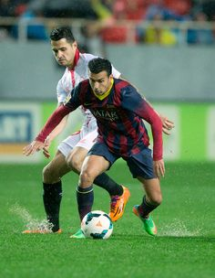 Pedro Rodriguez Ledesma (R) of FC Barcelona competes for the ball with Vctor Machin alias Vitolo (L) of Sevilla FC during the La Liga match between Sevilla FC and FC Barcelona at Estadio Ramon Sanchez Pizjuan on February 9, 2014 in Seville, Spain.