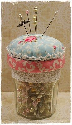 sweet  Would be really a great gift if you made it in Christmas Fabrics.  Pin cushion fits down into glass like a lid, so glass can store other items and pin cushion can store pins.