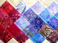 Sew a table runner inspired by the Sochi Olympics 2014. Easy patchwork, using scraps or batik fabric.
