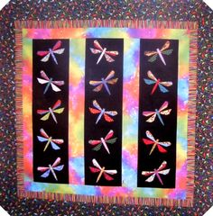 Wonderful Dragonfly Flurry Quilt pattersn from Love Quilt Patterns, Finished size Approximately 42 1/2 x 42 1/2 Beautiful quilt, maybe someone else can make it so I can buy it :)
