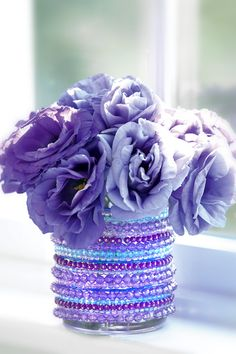 Make a jeweled vase from jar or dollar store vase and cheap beads. Mardi gras beads for me