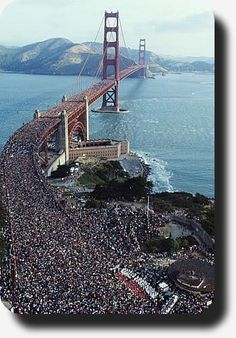 50th ANNIVERSARY OF THE GOLDEN GATE: On May 26, 1987 more than 250,000 people packed the famous bridge and another 500,000 people filled the approaches. For the first time in its history, the Golden Gate's arch completely flatten out.