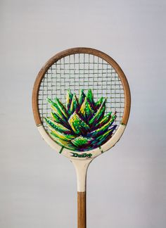 Designed by Cape-Town based artist Danielle Clough this wacky embroidered Aloe Vera vintage tennis  racket uses thick thread to create an almost 3D effect. Perfect inspiration for my Forever Living F.I.T. summer challenge! HTTP://www.aloeforever.uk.com