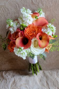 calla lilies, white snapdragons, green hypericum, ? coral wedding flowers - Google Search