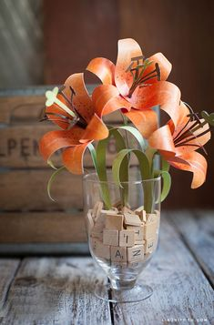 Make a gorgeous bouquet of  paper tiger lilies to brighten up any space with this easy-to-follow tutorial!