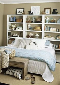 Bookshelf as a headboard. great idea for a small space! @Christie Moffatt Moffatt Moffatt Moffatt Moffatt Repcheck