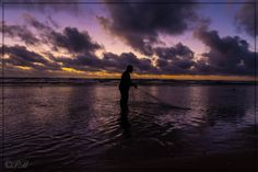 Fisherman at work - Getting up in the morning for fishing is so beautiful. The quiet morning, the colorful sunrise. Another day in paradise is coming. Kauai is waiting