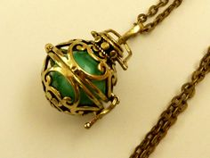 Noble Angel caller necklace Bola in gold with sound ball in mint green - pinned by pin4etsy.com