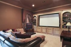 Really like the coziness and the color of the shelving, not a fan of the wall color and drapes tho...