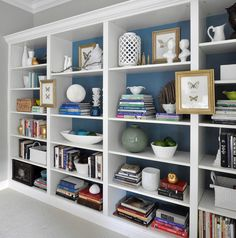 The BIlly Ikea bookcases as built-in  paint back of shelves  good ideas on how to style the bookcases