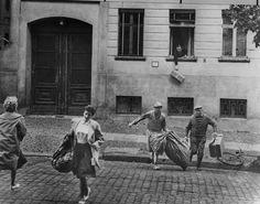 Berlin, Aug. 13, 1961, fleeing from the Eastern side of the street