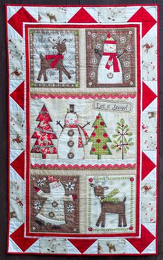 Holiday Stitches quilt kit, 29 3/4″ x 48″, at Flower Box Quilts. Fabric by Spectrix.