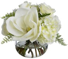 magnolia hydrangea and roses in a cute centerpiece