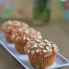 Hearty Spiced Carrot Muffins Recipe Breads with all-purpose flour, whole wheat flour, rolled oats, baking powder, baking soda, salt, ground cinnamon, ground cloves, ground nutmeg, ground ginger, milk, applesauce, brown sugar, vegetable oil, eggs, vanilla extract, carrots