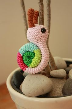 An amigurumi snail?  Why not!  This crocheted cuteness was found via Happy Amigurumi and the pattern can be bought at Laura's Etsy store- TinyAmigurumi - here.