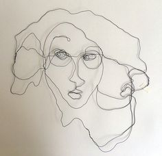 Wire portrait in one piece with paper collage. Size 50x50 cm. Title Clementine. Artist Agneta Pihlström