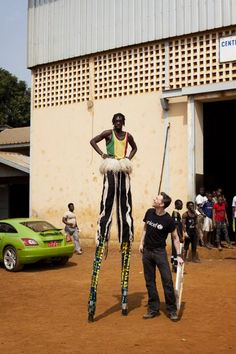 Tom hangs out with a super-tall performer from the UNICEF supported Project Tinafan circus school. © UNICEF 2013/Harry Borden