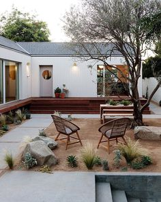 The home's courtyard is ideal for indoor/outdoor living. By opening the sliding glass doors, the kitchen space is connected to a courtyard dining space, which is ideal for family gatherings and entertaining. Modern Courtyard, Front Courtyard, Courtyard House, Courtyard Design, Indoor Courtyard, Courtyard Gardens, Courtyard Ideas, Patio Design, Indoor Outdoor Living