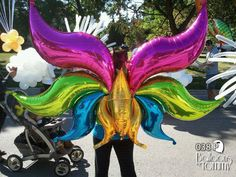 Balloons by Tommy - Photo Gallery - Parade Flair Balloon Dress, Balloon Arch, The Balloon, Columns Decor, Balloon Animals, Arabian Nights, Foil Balloons, Butterfly Wings, Balloon Decorations