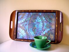 my grandma Grace had a tray like this, it was beautiful blue butterfly wings under glass.