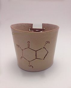 Leather coffee cup sleeve with a hand-drawn caffeine molecule using pyrography (writing with fire) - by Cinderworks Bags on Etsy