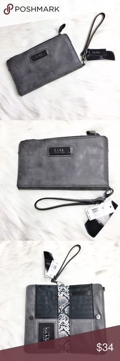 "Nicole Miller Wristlet Super trendy wristlet by Nicole Miller.  Wristlet is new with tags, has gray faux suede exterior and adorned with gun metal gray hardware.   Has a zippered pocket on the back and inside.  Has many areas to fit your cards and ID.  No material tag listed.  Measures 8"" x 4.5"" x 1"". Nicole Miller Bags Clutches & Wristlets"