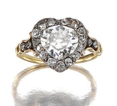 DIAMOND RING, EARLY 19TH CENTURY The heart-shaped bezel centring on a pear-shaped diamond within surrounds of circular- cut stones