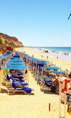 A Hotel to Remember: Pine Cliffs Hotel in the Algarve, Portugal - Beach or pool? Definitely the beach! It is one of the most beautiful beaches in the Algarve. The sun loungers are packed quite close together, because of the beach incline.