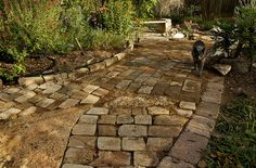 """The bricks are dry-set on a bed of compacted sand, and """"gravel-locked"""" with river gravel for large holes and granite sand for joints, cracks and smaller holes. All the brick is reclaimed."""