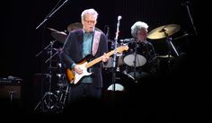 """Eric Clapton, center, performs during his """"70th Birthday Celebration"""" concert at Madison Square Garden on Friday, May 1, 2015, in New York. (Luiz C. Ribeiro/Invision/AP)"""